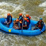 group-of-people-riding-blue-raft-on-body-of-water-1732280