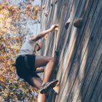 man-wall-climbing-beside-trees-976872