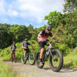 three-men-riding-on-bicycles-2158963